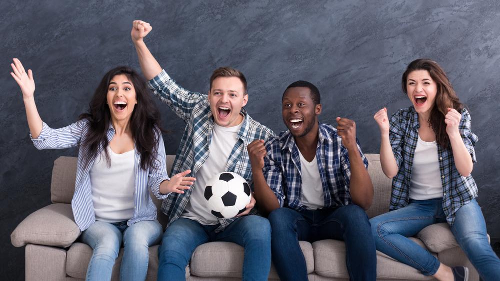 friends watching soccer